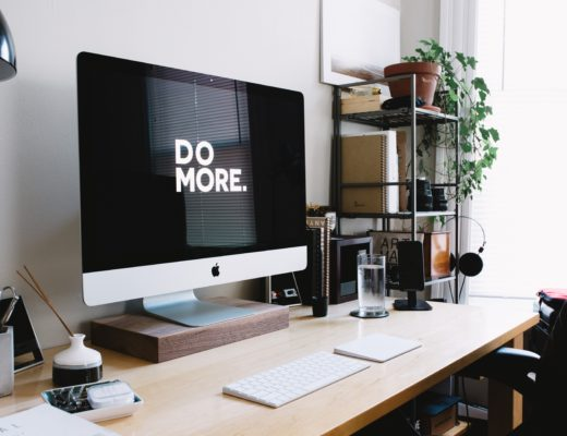 Macbook on desk that says do more