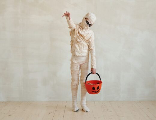 Kid in mummy costume trick or treating